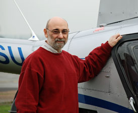 Photo of Rev Dr Sam Cappleman a helicopter pilot about to fly